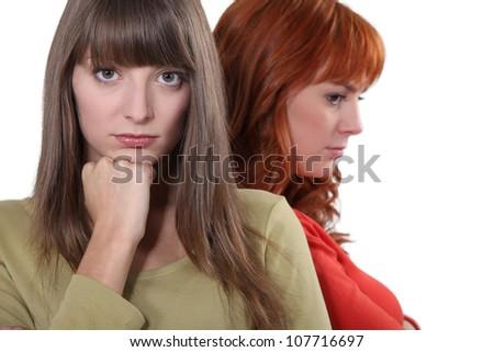 Two upset female friends - stock photo