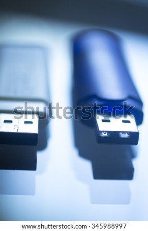 Two USB 3 flash drive III pendrive IT PC memory storage dongle plug socket close-up color artistic photo in blue tones. - stock photo