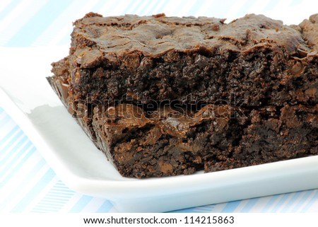 Two Vegan Brownies on a White Plate - stock photo