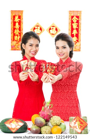 Two Vietnamese congratulating with traditional spring festival - stock photo
