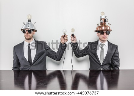Two vintage businessman sitting at office desk - stock photo
