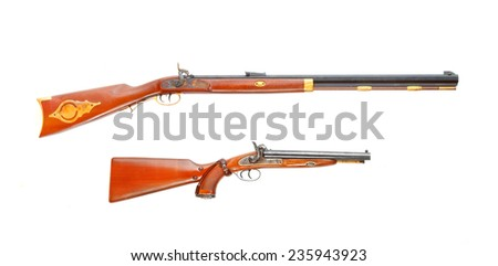 Two vintage weapons from american history used on the Wild West of the United States during the early frontier days in 19th century.  - stock photo