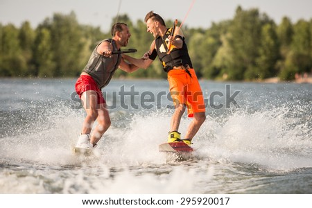 Two wake bord riders are having fun - stock photo