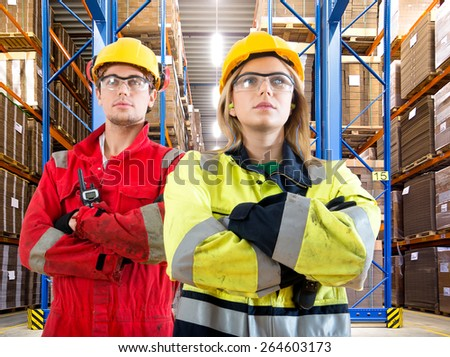 Two warehouse logistics employees looking confident as the new delivery arrives - stock photo