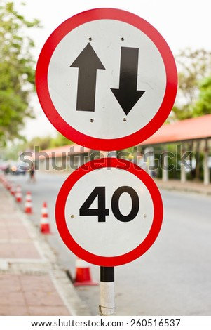 two way sign with speed limit - stock photo