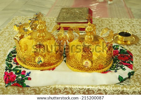 Two wedding crowns and  bible  on the church table - stock photo