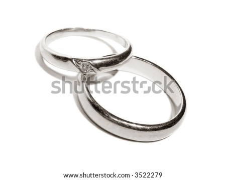 Two wedding gold rings close up platinum toned version - stock photo