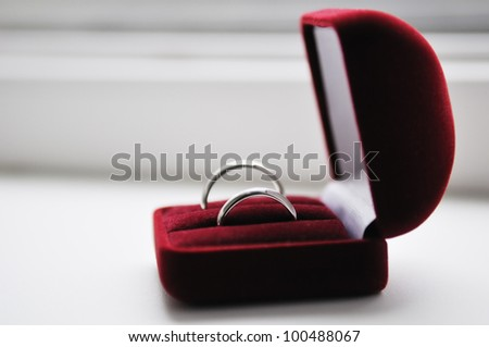 Two wedding rings in nice red box - stock photo