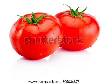 Two wet red tomatoes isolated on white background - stock photo