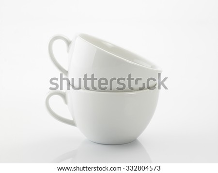 two white coffee cup stack up  - stock photo