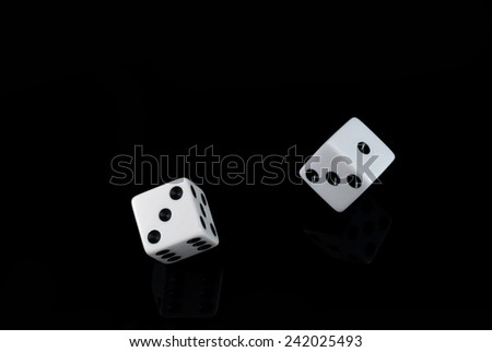 Two white dice on black reflect background - stock photo