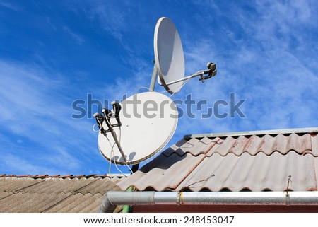Two white satellite dish on the roof - stock photo