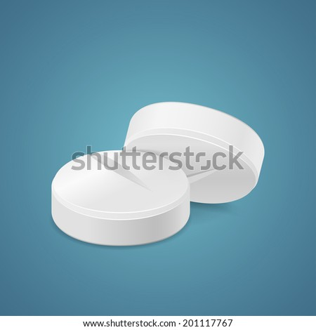 Two white tablets isolated on blue background - stock photo