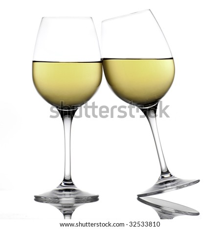 Two white wine glasses making a toast - stock photo