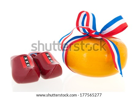 Two whole dutch cheeses with ribbon in flag colors on checked napkin isolated over white background - stock photo