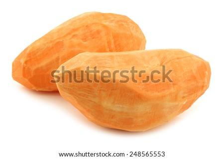 two whole peeled sweet potatoes on a white background - stock photo