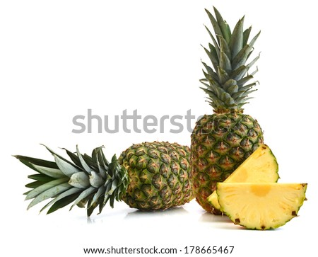 Two whole pineapple and slice. Isolated on a white background.  - stock photo