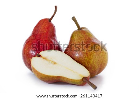 Two whole ripe pear and half a pear - stock photo