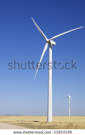 two windmills with a clear blue sky - stock photo