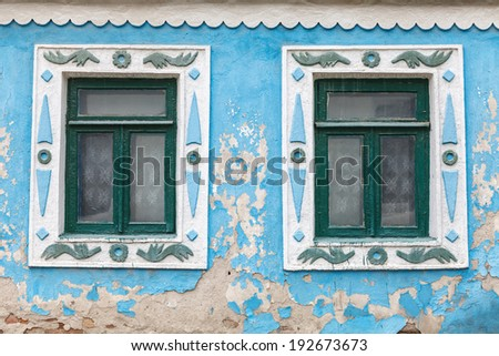 Two windows in an old house with cracked walls - stock photo