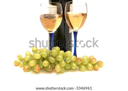 Two wine  glasses and cluster of grapes - stock photo