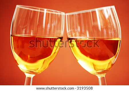 Two wine glasses on the biege background - stock photo