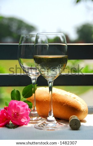 Two wine glasses with white wine - stock photo