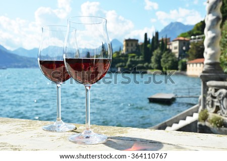 Two wineglasses. Varenna town at the lake Como, Italy - stock photo