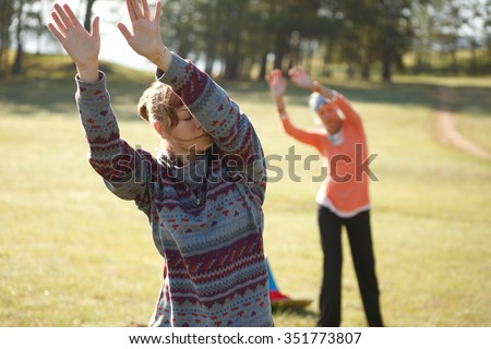 Two woman are practicing Qi Gong - stock photo