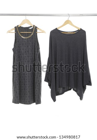 Two woman clothes on a hanger - stock photo