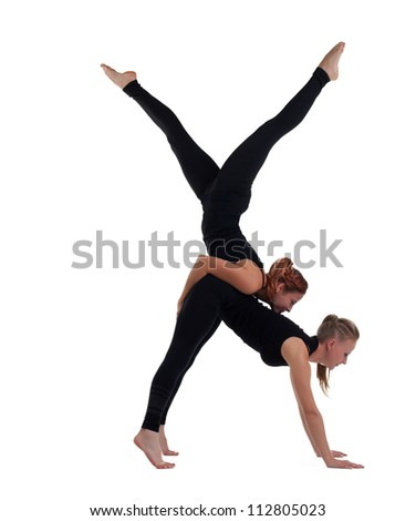 two woman gymnast in black show acrobatic exercise - stock photo