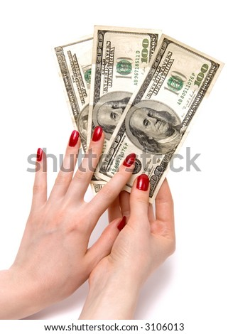 Two woman hands holding dollars. On white with shadows. - stock photo
