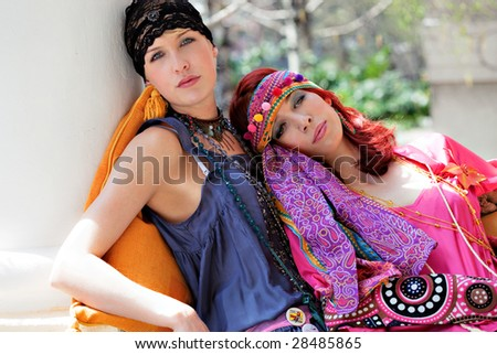 two woman in fashionable clothes - stock photo