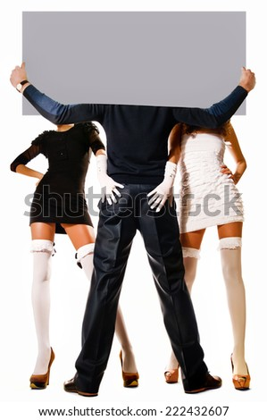 Two women and a man holding a sheet of paper - stock photo
