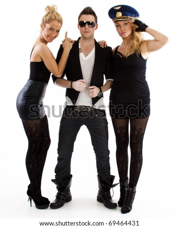 two women and a man in black - stock photo