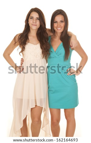 Two women are smiling with their arms around each other. - stock photo