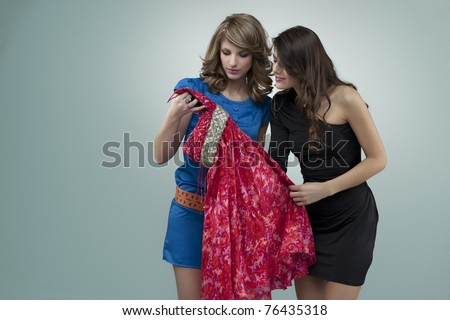 two women choosing flowers red dress - stock photo
