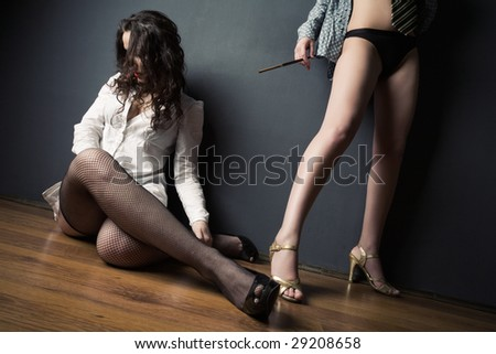 Two women conflict concept. Wide angle view. - stock photo