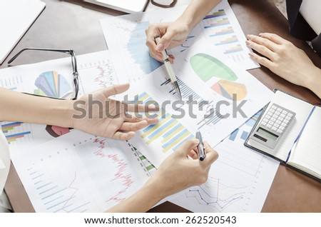 two women discussing business plan   - stock photo