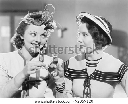 Two women drinking a schnapps - stock photo