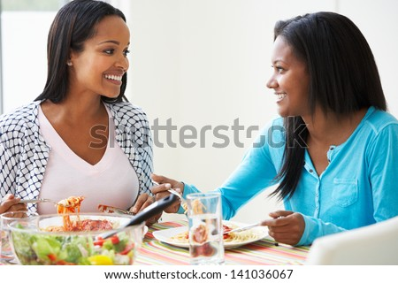 Two Women Eating Meal Together At Home - stock photo