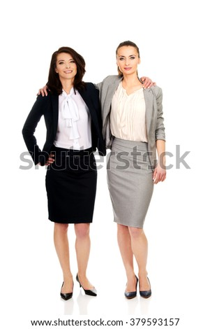 Two women embracing each other. - stock photo