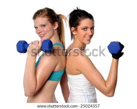 Two women exercising with dumbbells isolated over white background - stock photo