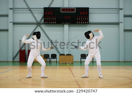 Two women fencers on a training  - stock photo