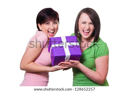 Two women give a gift - stock photo