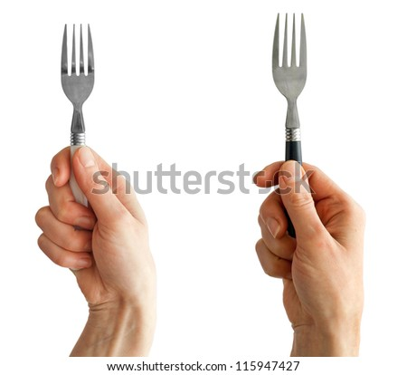 Two women hands holding forks with white and black handles - stock photo