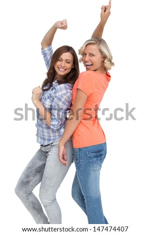 Two women having fun on white background - stock photo
