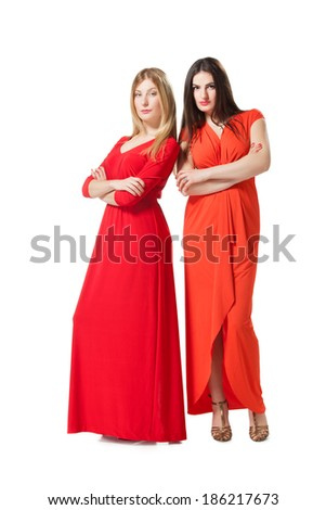 two women in long red dress - stock photo