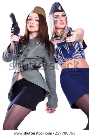 Two women in the military uniform with a guns isolated over white background - stock photo