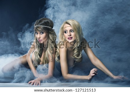 Two women like siren - stock photo